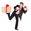 Man with falling gift box run. — Stock Photo #1336410