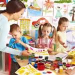 Children with teacher at school. — Stock Photo #29032159