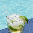Cocktail Majito on edge by poolside — Stock Photo #11369000