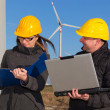 Two Engineers in Wind Turbine Power Generator Station — Stock Photo #5643872