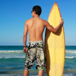 Surfer holding a surf board — Stock Photo #4917475