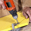 Carpenter with red drill — Stock Photo #1065197