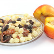 Breakfast cereal with dried fruits and fresh peaches — Stock Photo #3401014