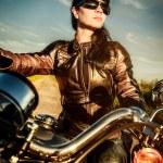 Biker girl on a motorcycle — Stock Photo #28568659