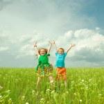 Joy children with flower — Stock Photo #4710923