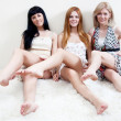 Three women showing their beauty legs — Foto de Stock   #3739852