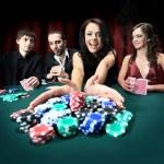 Young beautiful woman playing in casino — Stock Photo #12377004