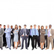 Business team formed of young businessmen and businesswomen standing over a — Stock Photo #5576676
