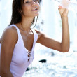 Young woman drinks mineral water — Stock Photo #1296134