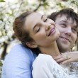 Embracing couple in spring nature closeup portrait — Stock Photo #46336549