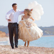 Wedding couple running on beach — Stock Photo #2787779