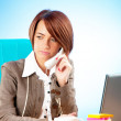 Young business woman working in the office — Stock Photo #5553458