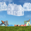 Lying couple on grass and dream three cloud houses collage — Stock Photo #7432566