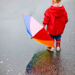 Toddler girl outdoors at rainy day — Stock Photo #3856619