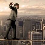Equilibrist businessman — Stock Photo #11019238