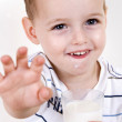 Portrait of smiling boy with milk glass — Stock Photo #1648955