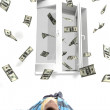 Young guy thinking of flying dollars — Stock Photo #1665432
