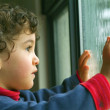 Little boy watching the rain — Stock Photo #1341728