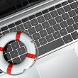 Support. Laptop and life preserver for first help. — Stock Photo #31011999