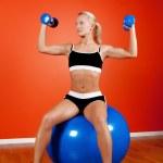 Athlete sitting on fitness ball — Stock Photo #1586486