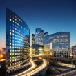 Bussines architecture - skyscrapers and light trails — Stock Photo #19915825