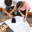 Couple With House Plans — Stock Photo #12192227