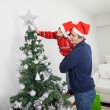 Son And Father Decorating Christmas Tree — Stock Photo #33781067