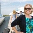 Happy Businesswoman Against Private Jet — Stock Photo #38964673