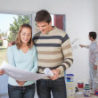 Couple going through house plan — Stock Photo #5734965