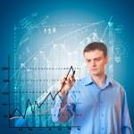 Businessman draws a graph. — Stock Photo #6402770