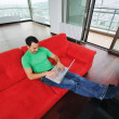 Man relaxing on sofa and work on laptop — Stock Photo #1674259