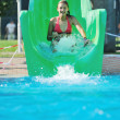 Girl have fun on water slide at outdoor swimmin — Stock Photo #1679286