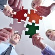 Group of business assembling jigsaw puzzle — Stock Photo #21021127