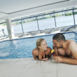 Happy cople at swimming pool — Stock Photo #3670058