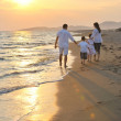 Happy young family have fun on beach at sunset — Stock Photo #5772689
