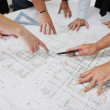Team of architects on construciton site — Stock Photo #6695177