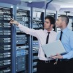 It enineers in network server room — Stock Photo #8338557