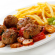 Roasted meatballs, French fries and vegetables — Stock Photo #8645061