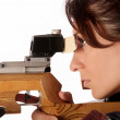 Woman aiming a pneumatic air rifle — Stock Photo #1912077