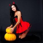 Imp with pumpkins — Stock Photo #6694649