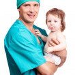 Surgeon with a baby — Stock Photo #6726165
