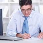 Senior businessman working in office — Stock Photo #10883876