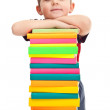 Little boy with pile of books — Stock Photo #5369454