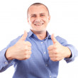Young happy businessman with thumbs up — Stock Photo #2012252