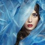 Fashion photo of beautiful women under blue veil — Stock Photo #22499831