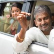 Indian man showing his new car key. — Stock Photo #47663571