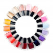 Coloured nail polish bottles stacked circle — Stock Photo #11981578