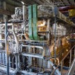 Giant pipes, tubes and equipment inside power plant, night scene — Stock Photo #21678683