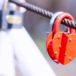 Heart shape padlock on bridge railing — Stock Photo #10476849