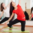 Group training in a gym of a fitness center — Stock Photo #19669099